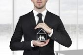 businessman protect house family
