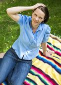 Woman Sitting In Park