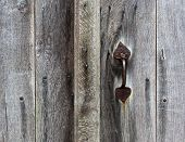 Rusty Doorhandle Of Wooden Door