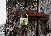 The Metal Lock On A  Old Wooden Door