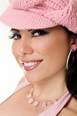 stock photo of pouty lips  - Beautiful woman smiling wearing pink hat jewellery and glamorous makeup - JPG