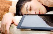 Teenager Sleeps With Tablet
