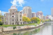 stock photo of raid  - Atomic Dome and the river view at Hiroshima memorial peace park Japan - JPG