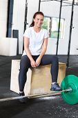Beautiful and smiling woman at crossfit center