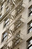 Stock Photo Of A Fire Escape On Historic Building poster