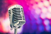 retro microphone on purple background