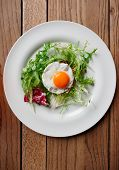 Beef tartar with fried egg and lettuce