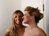 Two Smiling Blond Women Bare Shoulders Friends