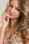 Beautiful, curly woman in cute dress