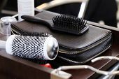 Hairdresser salon. Curler and comb on the nightstand