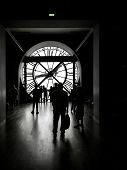 PARIS, FRANCE - AUGUST 25 2013: Silhouettes of tourists visiting d'Orsay Museum shot against big ext
