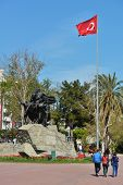 ANTALYA, TURKEY - MARCH 26, 2014: People walking under the monument to Ataturk on the Cumhurriet squ