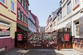 Hamburg, Germany - July 23, 2012: The entrance to the famous Herbertstrasse at St Pauli. Prostitutes offer their services from the windows here, therefor minors and women are prohibited to enter.