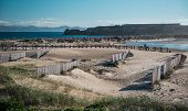 image of tarifa  - Breakwater in empty Tarifa beach - JPG