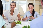 Business people enjoy healthy lunch in the office