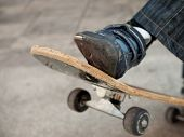 pic of skate board  - boy moves on a skate board turning arround - JPG