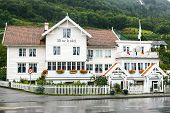 Old white wooden hotel in Utne, Norway