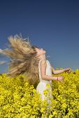 Young girl with Long Hair on a Rape Field