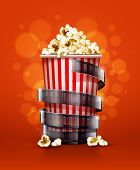 cinema concept with paper bucket with popcorn and film tape . Rasterized illustration.