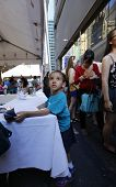 Little boy consults menu on 46th Street