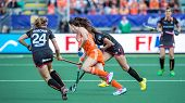 THE HAGUE, NETHERLANDS - JUNE 2: Dutch Star player Naomi van As rushes through two Belgian Defenders