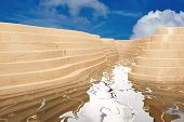 Abstract modern outdoor pool with wood under a blue sky (3D Rendering)