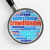 Crowdfunding concept tag cloud under a magnifying glass (3D Rendering)
