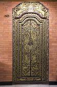 Richly ornamented, gilded wooden door in Indonesia