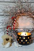 Composition with beautiful candlesticks, Christmas wreath and other decorations for home interior on wooden background