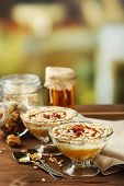 Tasty dessert with oat flakes and honey, on table