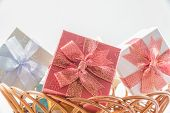 picture of gift basket  - Gift boxes on basket isolated for celebration such as Christmas New Year Birthday - JPG