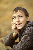 Happy boy in autumn park