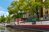 image of houseboats  - City view of Amsterdam canal and typical houseboat Holland Netherlands - JPG