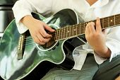 Young Young Playing Guitar