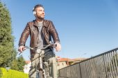 Man With Bicycle Walking Outdoors