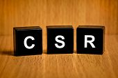 Csr Or Corporate Social Responsibility Word On Black Block