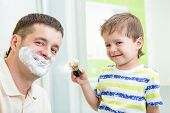 kid boy and father having fun in bathroom