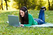 Woman  with headphones using laptop
