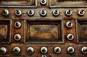 Ancient wooden door, reinforced wooden door, wooden carving