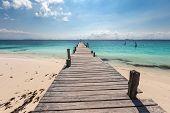 Wooden pier on tropical beach