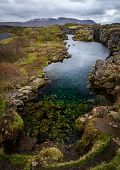 Lake Full Of Coins In Pingvellir National Park, Iceland