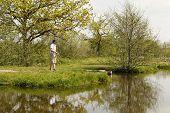 Fishermen At A Fishing Pond