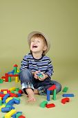 Child Playing With Blocks, Laughing, Fashion And Clothing
