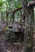 foto of pulley  - Old Water Well With Pulley and Bucket - JPG