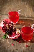 Glass Of Pomegranate Juice With Fresh Fruits On Wooden Table
