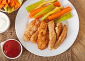 Chicken nuggets with sauce and vegetables