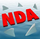 NDA acronym in red 3d letters on water surrounded by circling sharks to illustrate danger of breaking or violating a non-disclosure agreement