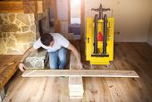 Handyman measuring wooden floor