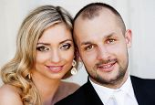 Portrait of happy young bride and groom