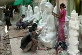 Burmese Man Carving And Woman Polishing  A Large Marble Buddha Statue.